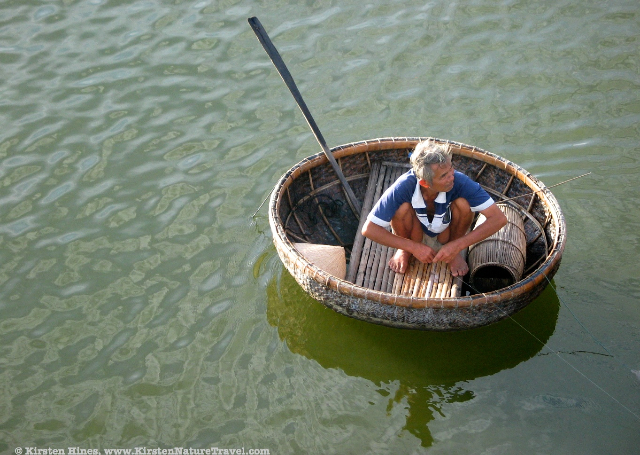 Fisherman in traditional boat